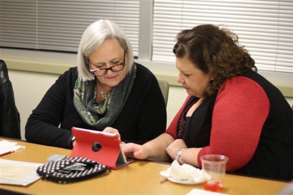 Peggy Everist and Kim Bonner using an iPad provided by the grant.